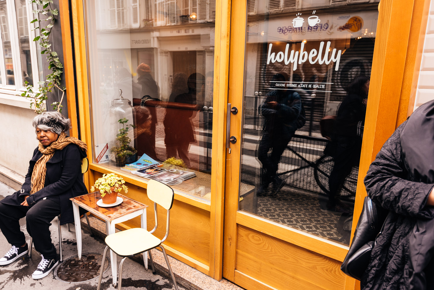 Waiting outside at Holybelly Paris