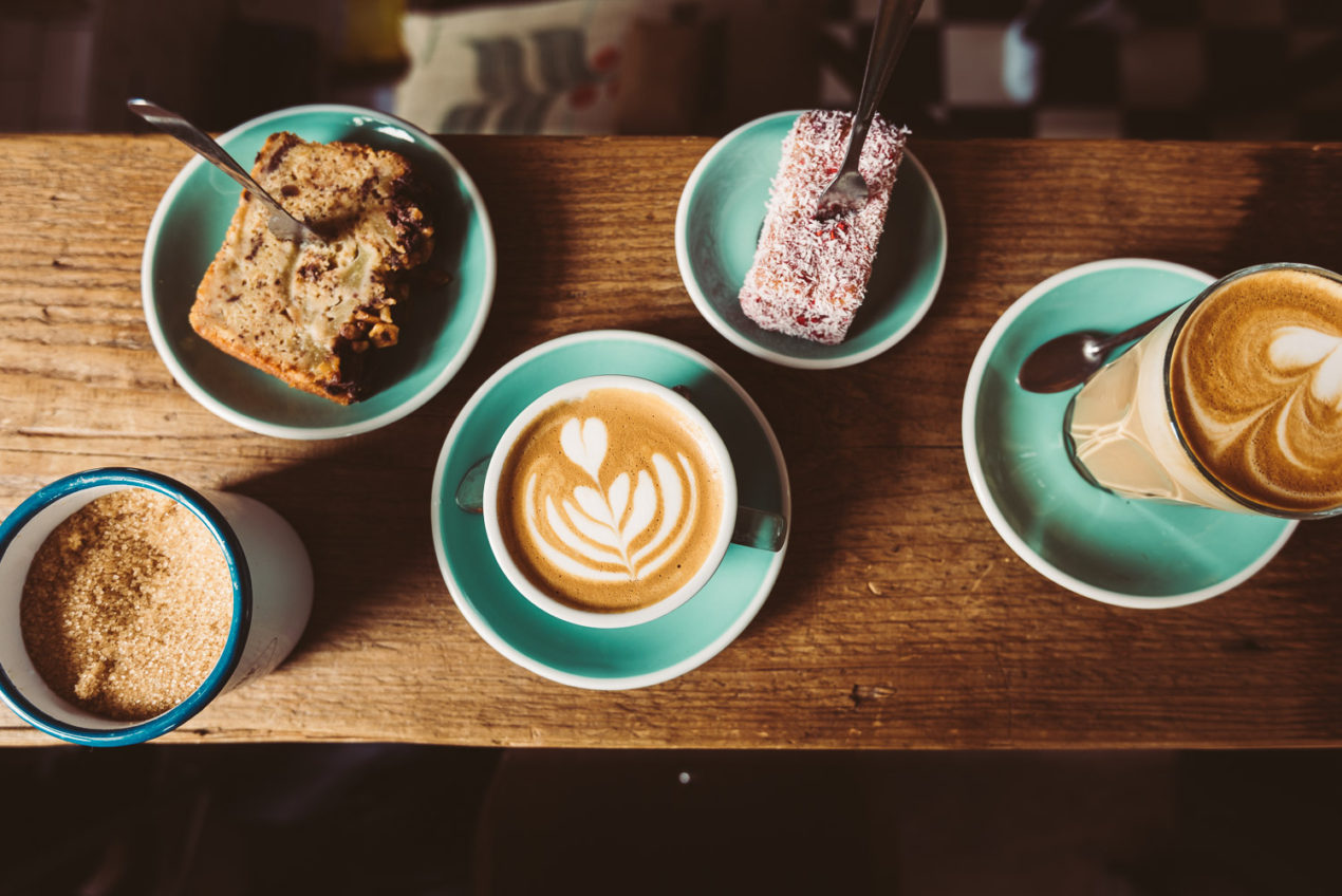 Pastries, latte and cortado flat lay at Lot Sixty One Coffee Roasters in Amsterdam