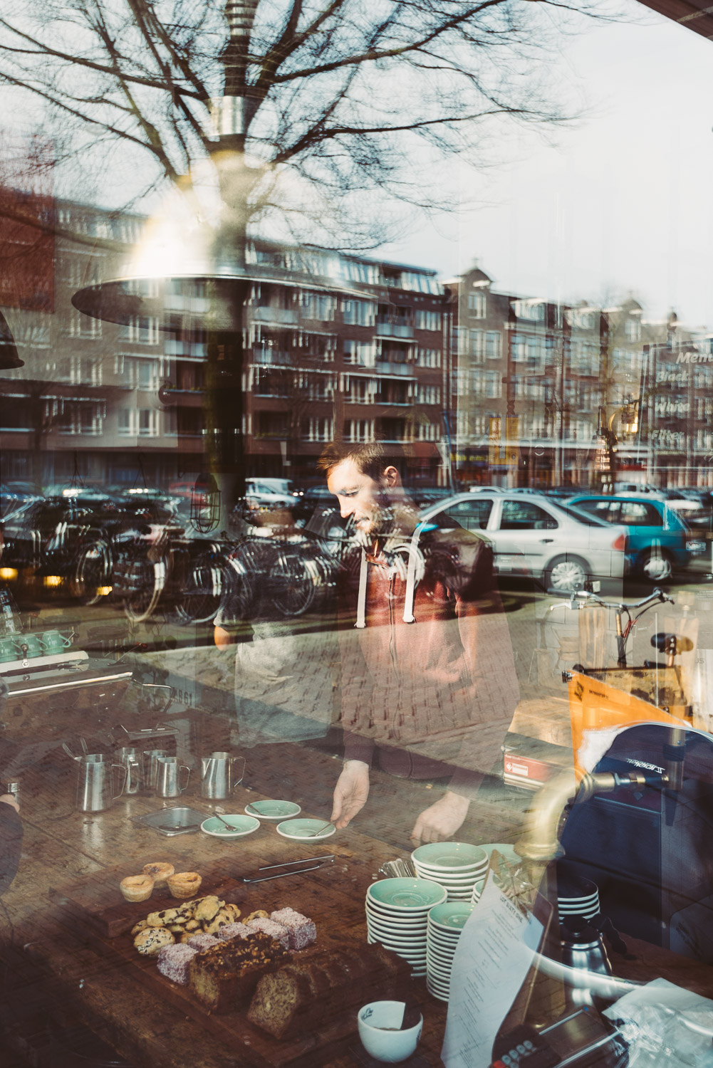 Barista at Lot Sixty One Coffee Roasters in Amsterdam